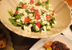 A hybrid Greek-Lebanese salad, with romaine, cucumber, tomato, parsley and mint, dressed with olive oil, lemon, garlic and salt. And topped with feta - lots and lots of feta!